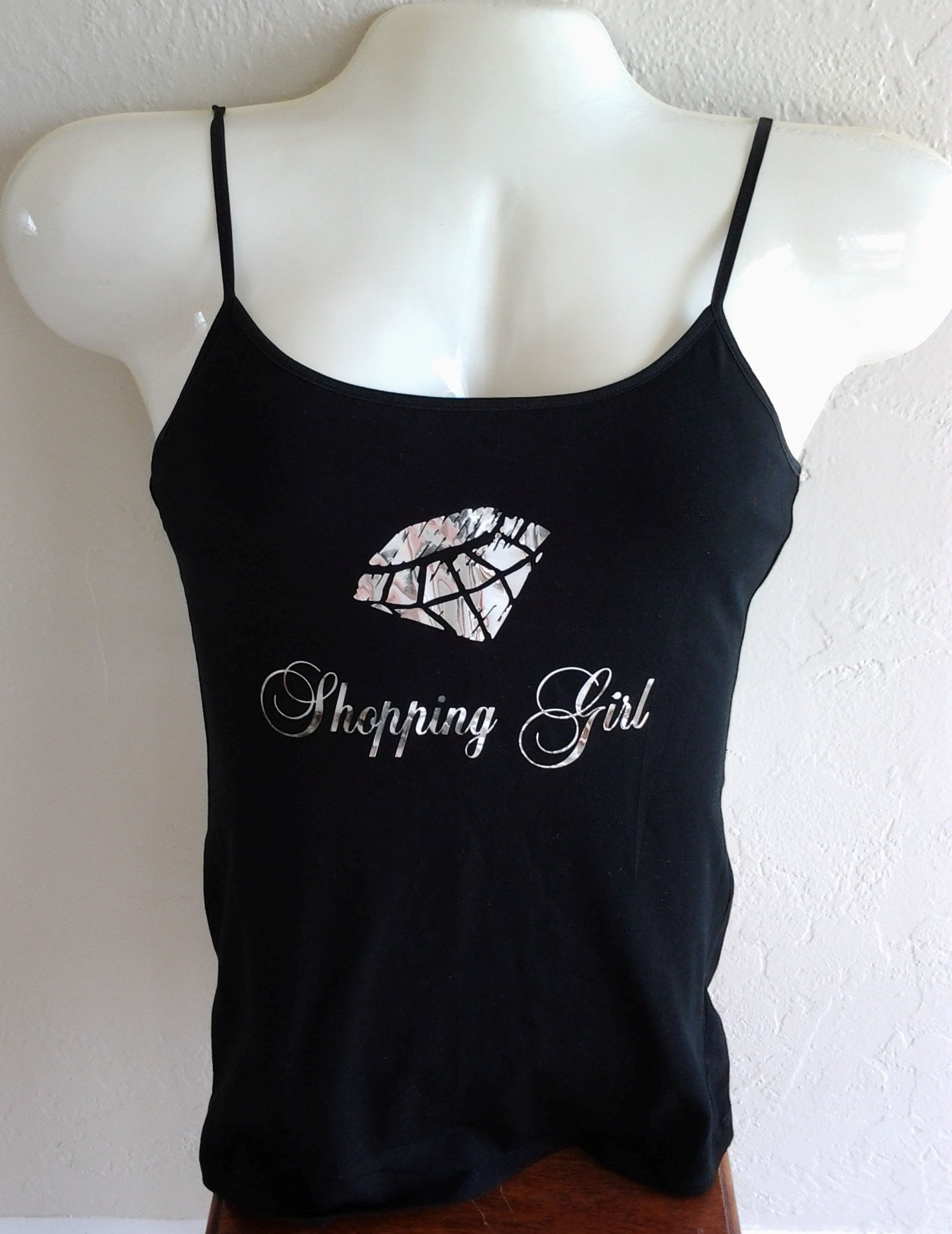 An über-popular ShoppingGirl.com T-shirt design featuring a metallic diamond pattern, created by Founder Tom in 2011.